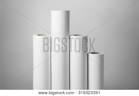 Blank White Paper Rolls Mockup Isolated On Gray Background