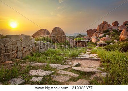 Ancient ruins in Hampi on sunset. Above Hampi Bazaar, Hampi, Karnataka, India
