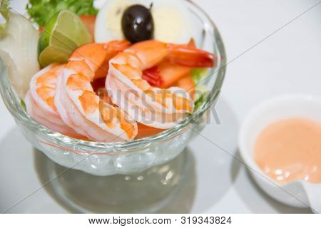 A Delicious Shrimp Cocktail Salad In Glass