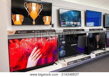 Minsk, Belarus - August 24, 2019: Samsung Tvs In A Branded Store.