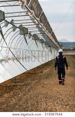 Logrosan, Extremadura, Spain - March 23, 2019: Worker Checking The Concentrators And Solar Panels Of