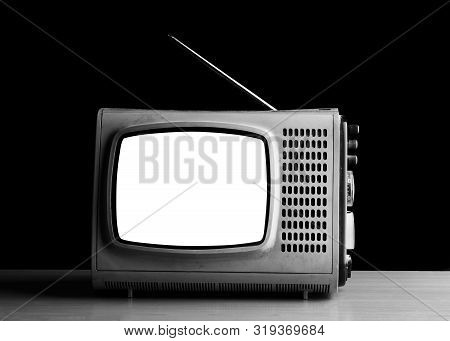 Old Vintage White Screen Tv For Photo Montage. Old Tv Close Up. Television Set. Old Tv On A Dark Bac