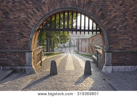 The Entrance To The Gate Of The Old Castle. The Road From Pavement, Fences From Unwanted Intrusion -