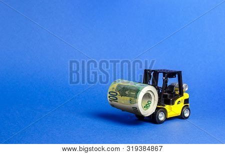 Forklift Truck Carries A Money Roll Of Euros. Export Of Capital. Attracting Direct Investment In Bus