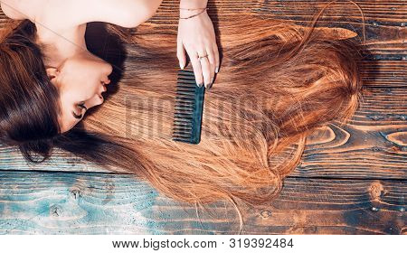 Perfect hair. Blonde brunette long hair. Perfect woman wood background. Beauty and perfect health hair. Beauty model with perfect clean skin and with good hair poster