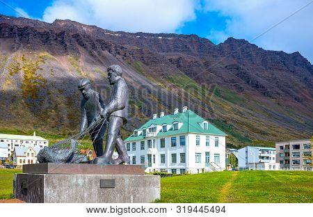 Isafjordur, Iceland - June 1, 2019: A Fishermen Monument In Tungata Square