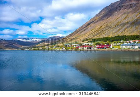 Isafjordur, Iceland, View Of The Bay With The Snowy Mountains  In The Background