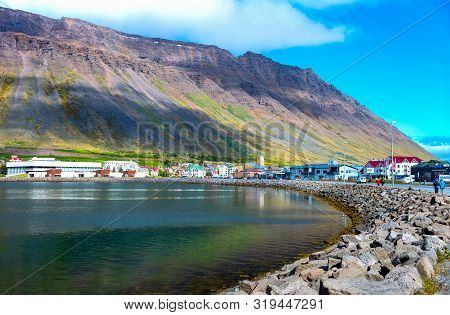 Isafjordur, Iceland - June 1, 2019:  People Walking Along The Bay