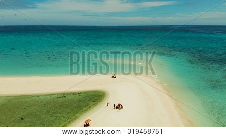 Tropical White Island And Sandy Beach With Tourists Surrounded By Coral Reef And Blue Sea, Aerial Vi
