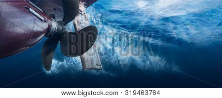 Propeller And Rudder Of Big Ship Underway View From Underwater. Close Up Image Detail Of Ship.
