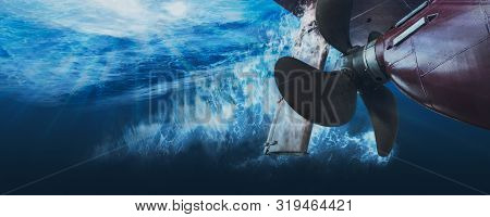 Propeller And Rudder Of Big Ship Underway View From Underwater. Close Up Image Detail Of Ship. Matte