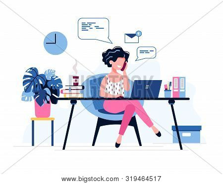 Happy Female Office Worker. Successful Businesswoman Uses Laptop, Speaks On The Phone Sitting At The