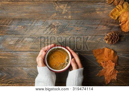 Young Caucasian Woman Girl In Knitted White Sweater Holds In Hands Mug With Freshly Brewed Coffee Wi