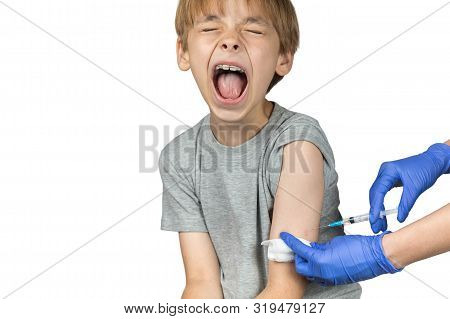 Caucasian Boy Has  A Hospital Appointment. Right  Arm Is The Site Of The Injection. He Is Afraid Of