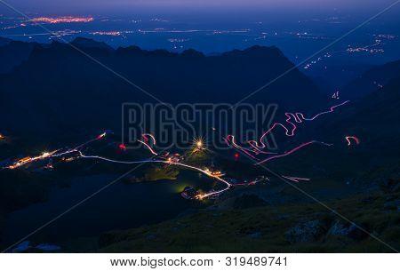 Spectacular Mountain Road In The Night, Lights On Winding Road, Transfagarasan Road In Romania, Nigh
