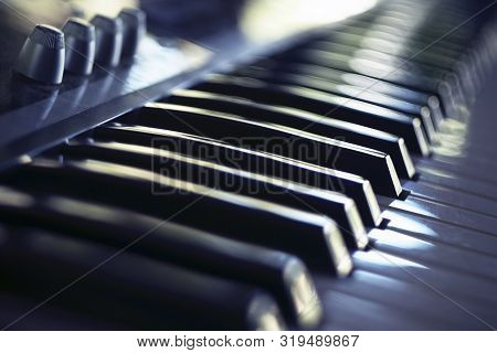Electric Piano Keyboard In Blur. Piano Keyboard With Day Light Reflections.