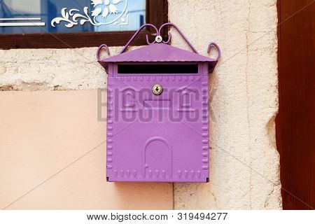 Mailbox. Purple Home Mailbox. Pink Mailbox On Rovinj Street, Croatia. Mediterranean Style Pink Mailb