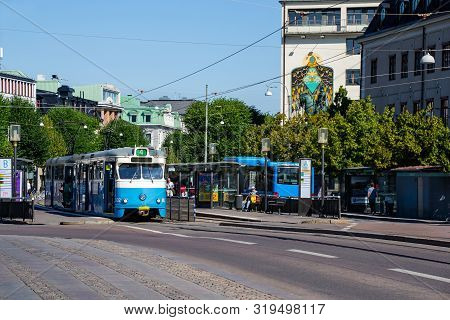 Gothenburg / Sweden - July 18 2019: A Blue Tram And A Bus, At The Bus Stop Kungsportsplatsen In The
