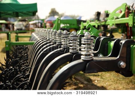 Spring Shock Absorbers Cultivator. A Fragment Of Agricultural Machinery For Loosening Plowed Fields.