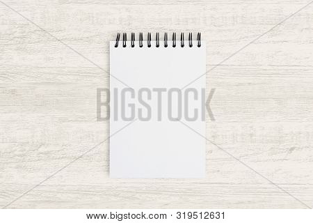 Top View For Business Background. Blank Notebook For Painting, Drawing And Sketching On Wood.
