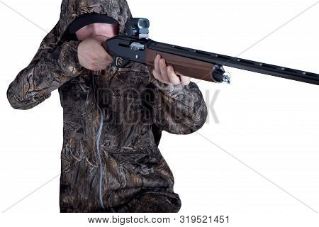Hunter In Camouflage Clothing With A Gun On White Background Isolated. The Man With The Shotgun. You