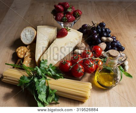 Wooden Table With Parmesan Cheese And Tomatoes. Variety Of Products. Food. Healthy Food. Wooden Boar