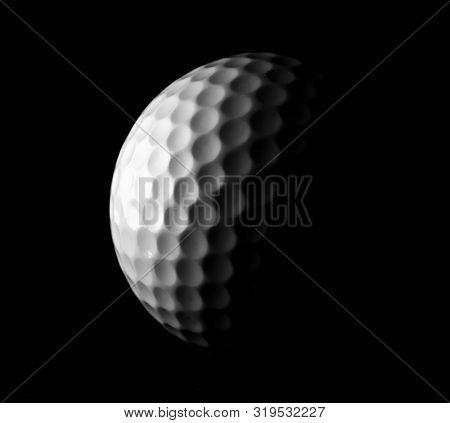 A Golf Ball As A Descending Moon