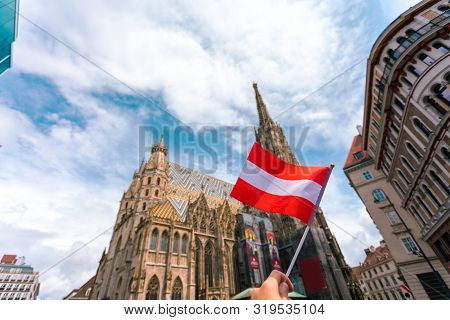 St. Stephens Cathedral On The Main Square Of Vienna In The Old Town With The Flag Of Austria In Fema