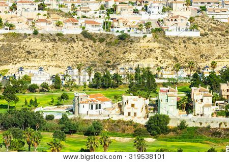 Panoramic Scenic View Of Luxury Golf And Country Club Playing Fields Lawns Surrounded By Villas In M