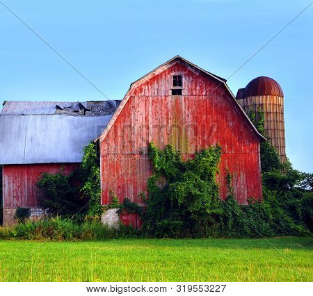 Faded Red Barn Is Falling Into Disrepair