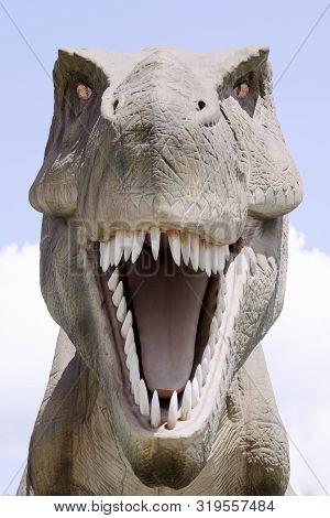 Front View Animal Portrait Of Extinct Tyrannosaurus Rex Dinosaur.