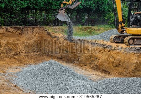 Backfilling Trench For The Gravel Stones At Construction Site In Excavator Backfill Of Foundation Di