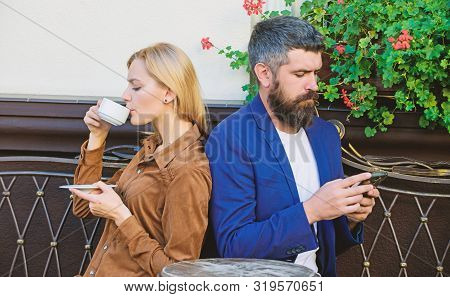 Couple In Love Sit Cafe Terrace Enjoy Coffee. Man Secret Messaging Cheating On Wife. Cheat And Betra