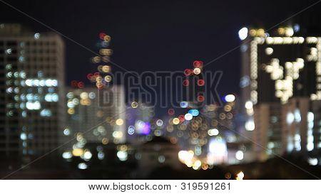 City Skyline Light At Night. Blur Bokeh Defocus Bangkok City Skyline Night Light. Buildings Light In