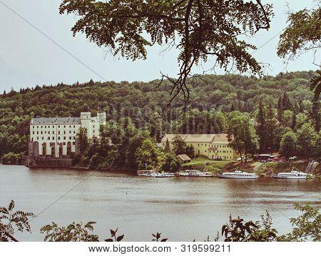 Orlik Castle Or Chateau Above Water Of Orlik Dam. Popular Schwarzenberg Medieval Stronghold In The S