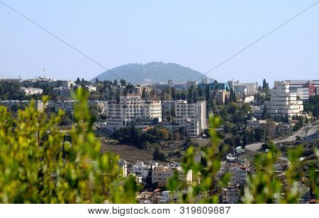 Nazareth, Israel - December 15, 2018: View Of The Modern Houses Of Upper Nazareth And Mount Tavor