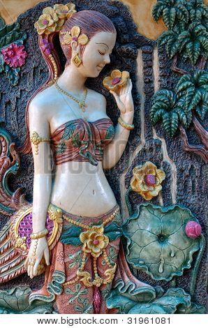 Thai's Ancient Woman Standing In Front Of A Tree.