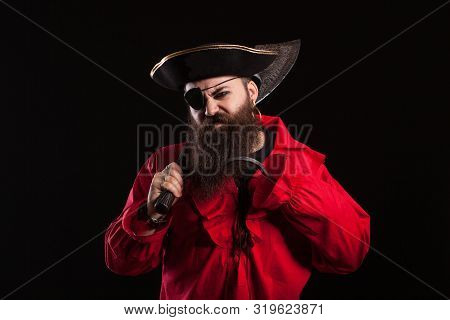 Angry Man In A Pirate Capitan Costume For Halloween Holding And Axe On His Shoulder
