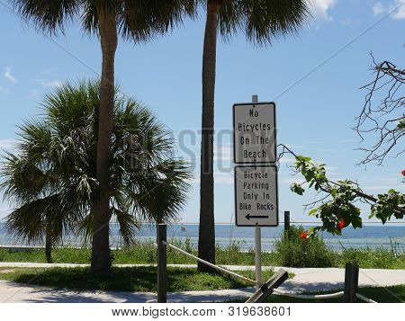 Signs on the roadside along the coastal S Roosevelt Boulevard in Key West, Florida. poster