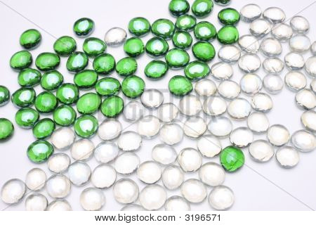 lots of green and white pebbles in the plain background poster