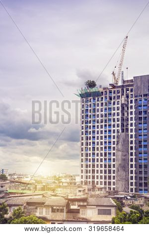Building Construction Of Modern Real Estate Homes With Tower Cranes Under Construction Working Site
