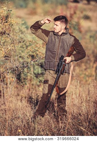 Hunting Permit. Bearded Serious Hunter Spend Leisure Hunting. Hunter Hold Rifle. Hunting Is Brutal M