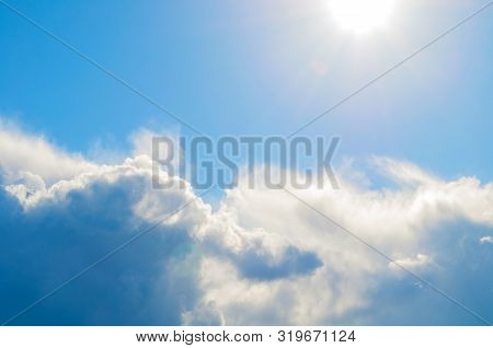 Blue dramatic sky background - picturesque colorful clouds lit by sunlight. Vast sky landscape panoramic scene, colorful sky background