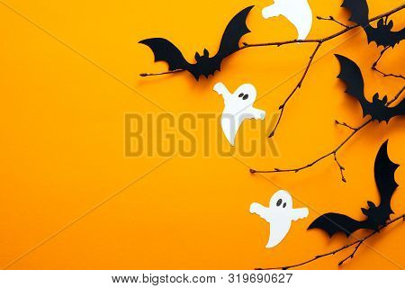 Happy Halloween Holiday Concept. Halloween Decorations, Bats, Ghosts On Orange Background. Halloween