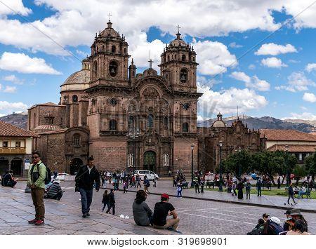 Cusco, Peru - 05/24/2019: Spanish Colonial La Compania In The Plaza De Armas In Cusco, Peru.