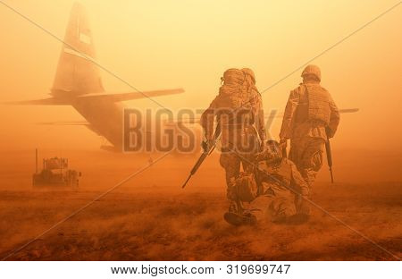 2 Soldiers Helping Wounded Soldier Between Dust In Battle Field To Board The Helicopter
