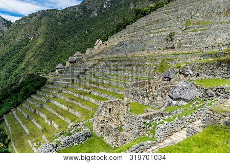 Machu Picchu, Peru - 05/21/2019: Steep Terraces At Lower Agricultural Section At The Inca Site Of Ma