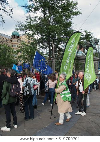 Leeds, West Yorkshire, United Kingdom - 29 August 2019: Green Peace Supporters In A Crowd With Flags