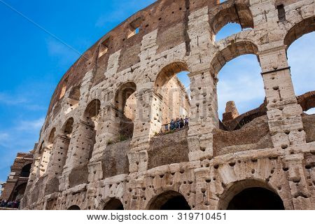 Rome, Italy - April, 2018: Tourists Visiting The Famous Colosseum Or Coliseum Also Known As The Flav