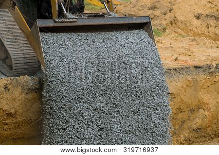 Excavator Bucket Backfilling Trench For Stone Backfill Of Foundation Excavator Bucket Working